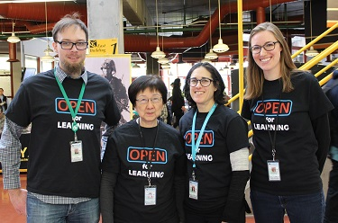 Library staff wearing Open for Learning shirts