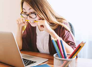 Image of stressed student at computer
